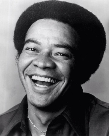 Publicity photo of Bill Withers (1976, Columbia Records).